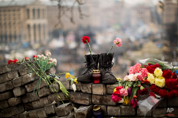 A pair of boots sits on top of a barricade at the Independence Square, in Kiev, Ukraine,, Thursday, Feb. 27, 2014. Ukraine put its police on high alert after dozens of armed pro-Russia men stormed and seized local government buildings in Ukraine's Crimea region early Thursday and raised a Russian flag over a barricade. (AP Photo/Emilio Morenatti)
