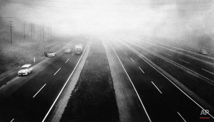 Autos and trucks creep through low-hanging smoke and fog on the New Jersey Turnpike, Nov. 20, 1953. The smog, blanketing the heavily industrialized Elizabeth-Newark area for four days, has resulted in scores being treated for eye irritation and burning sensations in nose and throat. (AP Photo)Air Pollution 1953