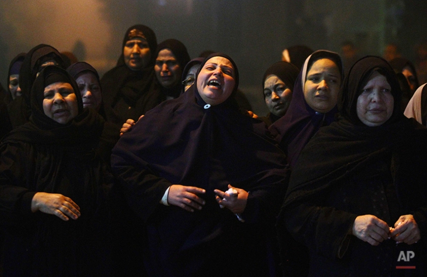 Relatives of 22 year-old journalist Mayada Ashraf, who was killed during clashes between Egyptian police and Muslim Brotherhood supporters, mourn during her funeral in El-Monofiya, north of Cairo, Egypt, Saturday, March 29, 2014. Ashraf, who worked for the privately owned El-Dustour newspaper, was one of four people killed during clashes between security forces and hundreds of supporters of ousted Egyptian president Mohammed Morsi who took to the streets Friday to protest the decision by the country's former military chief to run in upcoming presidential elections. (AP Photo/Ahmed Gomaa)