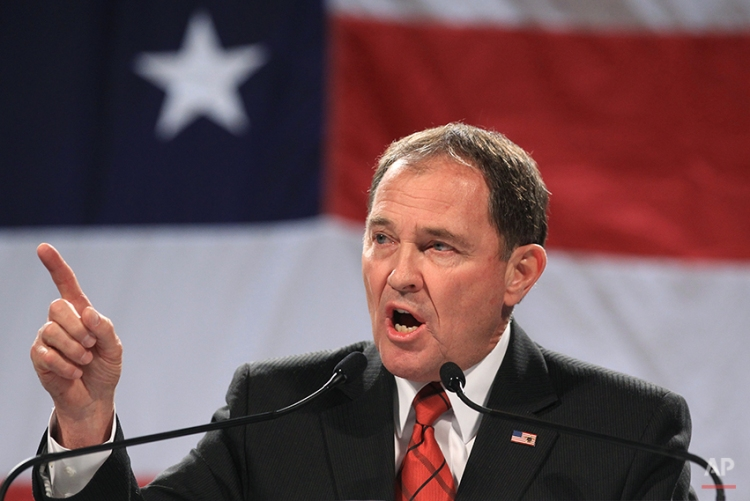 """In this April 25, 2014, file photo, Utah Gov. Gary Herbert addresses a crowd during a rally at the Western Republican Leadership Conference, in Sandy, Utah. Gov. Herbert said Thursday, May 22, 2014 that he remains committed to defending Utah's same-sex marriage ban, calling decisions by other state leaders to not defend bans the """"next step to anarchy."""" Herbert made the comments Thursday during his monthly televised news conference on KUED. (AP Photo/Rick Bowmer, File)"""