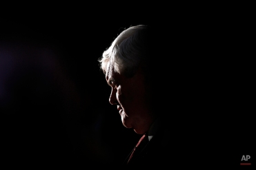 Republican presidential candidate former House Speaker Newt Gingrich speaks to members of the media after an event at a Holiday Inn, Wednesday, Jan. 25, 2012, in Cocoa, Fla. (AP Photo/Matt Rourke)