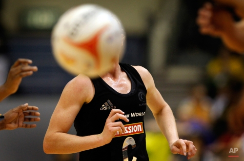 Laura Langman of New Zealand keeps a close watch on the ball while playing against Trinidad and Tobago during the third day of the Mission Foods World Netball Championships held on Wednesday July 6, 2011 in Singapore.(AP Photo/Wong Maye-E) License this photo