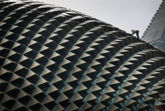 A worker perched on the roof of the Esplanade Theatre carries out the routine cleaning Wednesday, April 11, 2012 in Singapore. (AP Photo/Wong Maye-E) License this photo