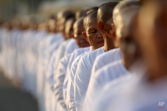 Hundreds of Buddhist nuns wait in line at the Royal Palace to pay their respects to the late former Cambodian King Norodom Sihanouk in Phnom Penh, Saturday, Feb. 2, 2013. Sihanouk's body had been lying in state at the Royal Palace after being flown from Beijing where he died Oct. 15 of a heart attack at the age of 89. The cremation, the climax of seven days of mourning, will take place Monday.(AP Photo/Wong Maye-E) License this photo