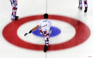 Norway's skip Thomas Ulsrud delivers the rock during the men's curling competition against the United States at the 2014 Winter Olympics, Monday, Feb. 10, 2014, in Sochi, Russia. (AP Photo/Wong Maye-E) License this photo