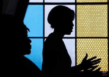 U.S. first lady Michelle Obama is seen in silhouette as she speaks at Regina Mundi Church and addresses the Young African Women Leaders Forum in a Soweto township, Johannesburg, South Africa, Wednesday, June 22, 2011. (AP Photo/Charles Dharapak, Pool)