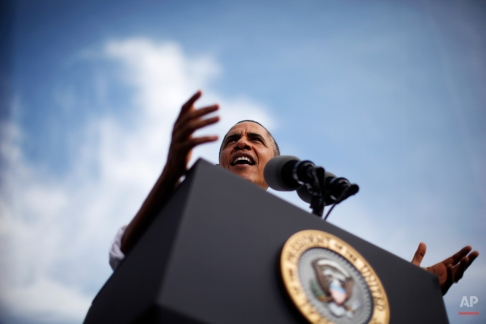 President Barack Obama speaks about the government shutdown and debt ceiling during a visit to M. Luis Construction, which specializes in asphalt manufacturing, concrete paving, and roadway reconstruction, Thursday, Oct. 3, 2013, in Rockville, Md. (AP Photo/Charles Dharapak)