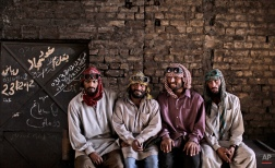Pakistanis working at a steel mill, from right, Nazir Hameed, 42, Khalil Zada, 24, Azeem Ibrahim, 31, chat with another worker, not pictured, during a break, in Islamabad, Pakistan, Wednesday, May 23, 2012. (AP Photo/Muhammed Muheisen)