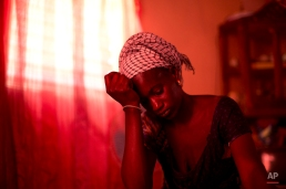 In this Oct. 10, 2013 photo, Aida Diallo, whose ten-year-old son Bamba was killed when a fire struck the Dakar shack where he was sleeping along with other Quranic students, sits in her one-room home in the village of Ndame, Senegal. Bamba's older brother Cheikhou, 13, managed to escape the fire which killed Bamba and three of their cousins. (AP Photo/Rebecca Blackwell)