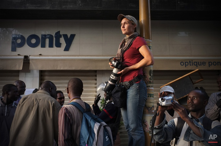 Rebecca Blackwell is seen on assignment at a 2012 protest in Senegal. (Photo by Dominque Derda)