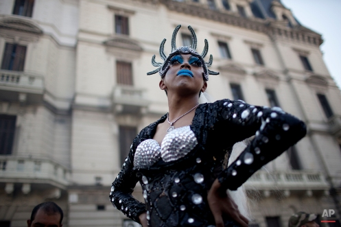 A person in costume poses for a portrait during the annual Gay Pride parade in Buenos Aires, Argentina, Saturday, Nov. 15, 2014. Lesbian, gay, bisexual, and transgender rights in Argentina are among the most advanced in Latin America, being the first country of this region to legalize same-sex marriage and Congress approving in 2012 the Argentina Gender Identity Law which enabled people to change their names and sexes on official documents without first getting approval from a judge or doctor. (AP Photo/Natacha Pisarenko)