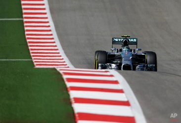 Mercedes driver Nico Rosberg, of Germany, races his car during qualifying for the Formula One U.S. Grand Prix auto race at the Circuit of the Americas, Saturday, Nov. 1, 2014, in Austin, Texas. Rosberg will start in pole position for tomorrow's race. (AP Photo/Eric Gay)