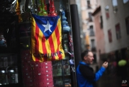 A bag with the estelada or pro independence flag is displayed in Barcelona, Spain, Monday, Nov. 10, 2014. Catalonia's government said more than a million voters participated Sunday in an informal vote on whether the wealthy northeastern region should secede from the rest of Spain. The regional Catalan government pushed forward with the vote despite Spain's Constitutional Court ordering its suspension on Tuesday after it agreed to hear the Spanish government's challenge that the poll is unconstitutional. (AP Photo/Manu Fernandez)