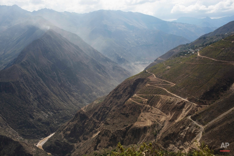 In this Oct. 28, 2014 photo, switch-back roads cover the mountains above the Mantaro river in Ayahuanco, Peru. Though the Shining Path was defeated two decades ago, cocaine-funded rebel remnants continue to hound Peru's security forces in the remote region. (AP Photo/Rodrigo Abd)