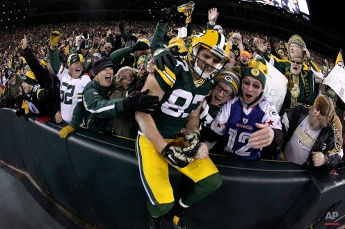 Green Bay Packers wide receiver Jordy Nelson (87) celebrates a touchdown with fans during the first half of an NFL football game against the Chicago Bears Sunday, Nov. 9, 2014, in Green Bay, Wis. (AP Photo/Morry Gash)
