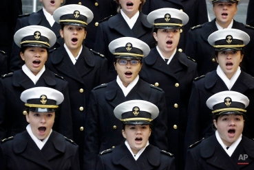 Members of The United States Naval Academy sing prior to a Veterans Day commemoration Ceremony at Soldier Field Tuesday, Nov. 11, 2014, in Chicago. (AP Photo/M. Spencer Green)