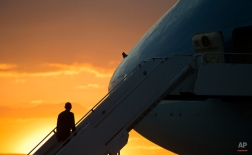President Barack Obama prepares to board Air Force One prior to his departure at Yangon International Airport, Friday, Nov. 14, 2014 in Yangon, Myanmar. Obama is traveling is Australia to attend the G20 summit in Brisbane. (AP Photo/Pablo Martinez Monsivais)