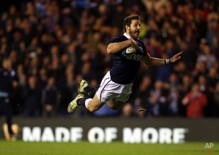 Scotland's Tommy Seymour scores his try during the international rugby match against Argentina at Murrayfield, Edinburgh, Scotland, Saturday Nov. 8, 2014. (AP Photo/Scott Heppell)