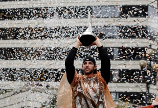 San Francisco Giants pitcher Madison Bumgarner holds the World Series MVP trophy during the victory parade for the 2014 baseball World Series champions, Friday, Oct. 31, 2014, in San Francisco. (AP Photo/Marcio Jose Sanchez)