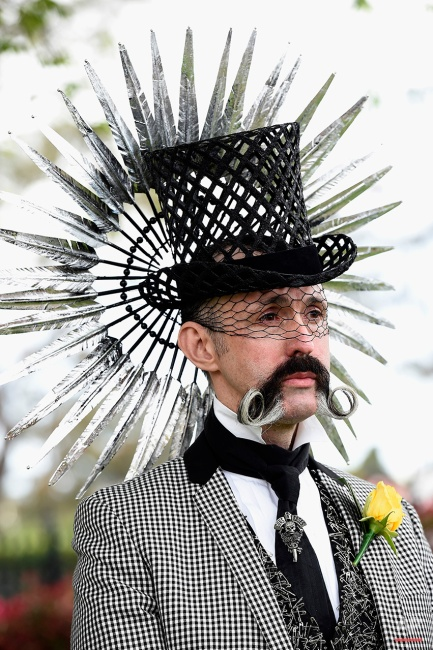 A man arrives at the Flemington Racecourse before the running of the Melbourne Cup horse racing in Melbourne, Australia, Tuesday, Nov. 4, 2014. (AP Photo/Andy Brownbill)