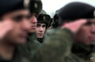 Conscripts stand at a military conscription office in Grozny, Chechnya's provincial capital, Russia, Monday, Nov. 17, 2014. The Russian military has begun drafting conscripts from the province of Chechnya for the first time since a separatist war. (AP Photo/Musa Sadulayev)