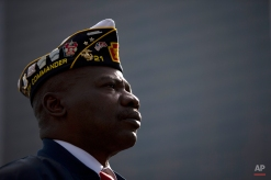 Vietnam veteran The Rev. Dr. Lawrence Brown listens to remarks during a ceremony on Veterans Day, Tuesday, Nov. 11, 2014, at the The All Wars Memorial to Colored Soldiers and Sailors in Philadelphia. Americans marked Veterans Day on Tuesday with parades, speeches and military discounts, while in Europe the holiday known as Armistice Day held special meaning in the centennial year of the start of World War I. (AP Photo/Matt Rourke)