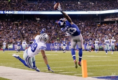 In this Nov. 23, 2014, New York Giants wide receiver Odell Beckham Jr. (13) makes a one-handed catch for a touchdown against Dallas Cowboys cornerback Brandon Carr (39) in the second quarter of an NFL football game in East Rutherford, N.J. The one-handed catch by Odell Beckham Jr. that became the most talked-about play from Sunday did more than just boost his standing with the New York Giants, it paid off a routine growing popular among many skill players of practicing the impractical, one-handed circus grab. (AP Photo/Julio Cortez)
