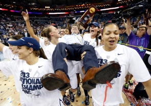 Connecticut players celebrate as they carry their head coach Geno Auriemma after defeating Louisville 93-60 in the national championship game of the women's Final Four of the NCAA college basketball tournament, Tuesday, April 9, 2013, in New Orleans. (AP Photo/Dave Martin)