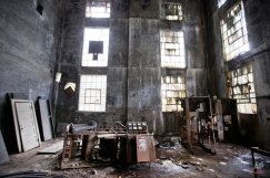 In this Oct. 15, 2014 photo, rusted equipment sits on the floor of an abandoned coal power plant in Lynch, Ky. The community of Lynch, built as a company town in 1917 by U.S. Coal and Coke, a subsidiary of U.S. Steel, was at the time the largest coal camp in the world. It was built to house the many workers mining the coal to be used by U.S. Steel. The population peaked to around 10,000 but has since diminished to roughly 747 according to a 2010 census. The plant now sits abandoned across the street from the old mines that have since been turned into a museum. (AP Photo/David Goldman)