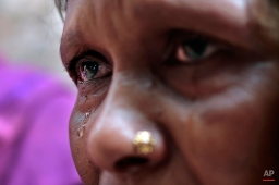 A Bangladeshi woman cries for her missing relative on the second anniversary of the Nov. 24, 2012 fire at Tazreen Fashions that killed over a hundred workers, outside its factory in Savar, on the outskirts of Dhaka, Bangladesh, Monday, Nov. 24, 2014. Garment factory workers, activists and relatives of the victims still protest demanding compensations for the survivors and a full account of the missing. (AP Photo/A.M. Ahad)