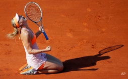 Russia's Maria Sharapova reacts after defeating Romania's Simona Halep during their final match of the French Open tennis tournament at the Roland Garros stadium, in Paris, France, Saturday, June 7, 2014. Sharapova won 6-4, 6-7, 6-4. (AP Photo/David Vincent, File)