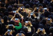 """Delegates use their smartphones to take pictures of Russian President Vladimir Putin speaks during a dialogue session with delegates during the APEC CEO Summit, """"What does the Asia Pacific mean to Russia"""" as part of the Asia-Pacific Economic Cooperation (APEC) Summit at the China National Convention Center in Beijing, China Monday, Nov. 10, 2014. (AP Photo/Andy Wong)"""