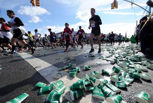 Empty water cups from thirsty runners litter Vernon Blvd in Long Island City during the New York City Marathon on Sunday, Nov. 2, 2014, in New York. (AP Photo/Kathy Kmonicek)