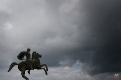 A modern bronze statue of Alexander the Great on his famous horse Bucephalus stands under the cloudy sky of the northern port city of Thessaloniki, Greece on Wednesday, Oct, 8, 2014. Alexander the Great was one of history's most successful military commanders, who by his death aged 33 had conquered an empire stretching from modern Greece to India. (AP Photo/Petros Giannakouris)