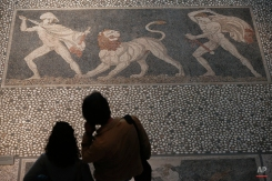 Visitors look at a mosaic pavement believed to portray Alexander the Great, left, and his friend and military commander Craterus during a lion hunt, at the archeological museum of Alexander's birthplace Pella, Greece, onTuesday, Oct. 7, 2014. Alexander the Great was one of history's most successful military commanders, who by his death aged 33 had conquered an empire stretching from modern Greece to India. (AP Photo/Petros Giannakouris)