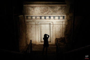 """A visitor takes a picture of the facade of a tomb believed to belong to the ancient Greek King Philip II of Macedon, who reigned from 359 to 336 B.C, at Vergina museum, northern Greece, onTuesday, Oct. 7, 2014. According to archaeologist Angeliki Kottaridi, head of the archaeological sites of Vergina and Pella, Philip II was the first to succeed in uniting Greece's squabbling city-states. """"Philip effectively received a fractured state when he became king in 359 (B.C.), and, in 25 years, succeeded in creating the greatest power of his time through Ö substantial military, economic and social reforms,"""" she told the AP. (AP Photo/Petros Giannakouris))"""