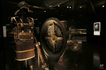 The gold-decorated iron body armor, sword and ceremonial shield of ancient Greek King Philip II of Macedon is displayed at Vergina museum, northern Greece, onTuesday, Oct. 7, 2014. Philip II reigned from 359 to 336 B.C. expanding his kingdom to include Greece's perennially squabbling city states. His son and successor, Alexander the Great, who distinguished himself in Philip's Greek campaigns, expanded Macedonian rule at the head of a Greek army, reaching as far as the borders of India. (AP Photo/Petros Giannakouris)