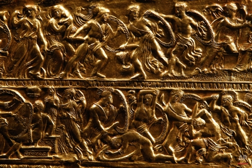 Battle scenes appear in a detail from a golden bow-case, believed to have belonged to a Scythian princess, that was found in a richly furnished tomb believed to belong to ancient Greek King Philip II of Macedon, is displayed at Vergina museum, northern Greece, on Tuesday, Oct. 7, 2014. Philip II reigned from 359 to 336 B.C. expanding his kingdom to include Greece's perennially squabbling city states. His son and successor, Alexander the Great, who distinguished himself in Philip's Greek campaigns, expanded Macedonian rule at the head of a Greek army, reaching as far as the borders of India. (AP Photo/Petros Giannakouris)