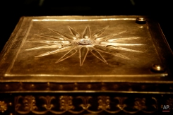 A heavy solid gold casket from the rich, unplundered tomb of Philip II of Macedon, which contained the assassinated king's burnt bones, is displayed at Vergina museum, northern Greece, onTuesday, Oct. 7, 2014. Philip reigned from 359 to 336 B.C. expanding his kingdom to include Greece's perennially squabbling city states. His son and successor, Alexander the Great, who distinguished himself in Philip's Greek campaigns, expanded Macedonian rule at the head of a Greek army, reaching as far as the borders of India. (AP Photo/Petros Giannakouris)