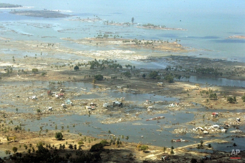 A wide swath of destruction of Banda Aceh brought about by Sunday's earthquake-triggered tsunami is shown from a commercial plane Thursday, Dec. 30, 2004 in Aceh province northwest of Indonesia. (AP Photo/Eugene Hoshiko)