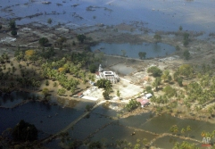 A mosque stands amidst a wide swath of destruction in Banda Aceh brought about by Sunday's earthquake-triggered tsunami as shown from the commercial plane Thursday Dec. 30, 2004 in Aceh province northwest of Indonesia. (AP Photo/Eugene Hoshiko)