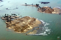 Islets are formed of what used to be part of Banda Aceh, the capital of Aceh province in northwest of Indonesia, as seen from a commercial plane on Thursday Dec. 30, 2004 following Sunday's earthquake-triggered tsunami. (AP Photo/Eugene Hoshiko)