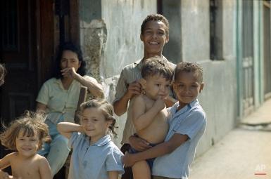 Children smile for a photographer in Havana, Cuba, Nov. 1971. (AP Photo/Beverley Reed)