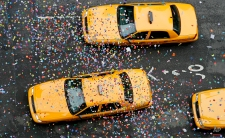"""Taxis driving down Seventh Avenue are strewn with confetti tossed during an """"air worthiness test"""" of the confetti used during Monday's New Year's Eve celebration in Times Square seen Saturday, Dec. 29, 2007, in New York. (AP Photo/Jason DeCrow)"""