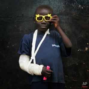 Glen Amadi, 6, poses in an orphanage on the outskirts of Nairobi, Kenya, Friday Feb. 15, 2008. (AP Photo/Bernat Armangue)