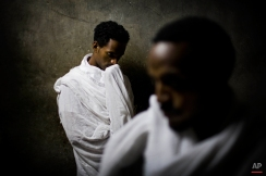 Ethiopian Orthodox Christian pilgrims pray inside the Church of the Holy Sepulcher, traditionally believed to be the site of the crucifixion of Jesus Christ, during the Eastern Orthodox Easter week in Jerusalem's Old City, Wednesday, March 31, 2010. (AP Photo/Bernat Armangue)