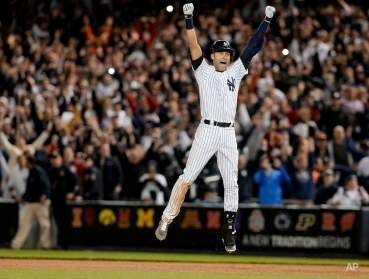 New York Yankee Derek Jeter jumps after hitting the game-winning single against the Baltimore Orioles in the ninth inning of a baseball game, Thursday, Sept. 25, 2014, in New York. The Yankees won 6-5. It was Jeter's last home game of his career at Yankee Stadium. (AP Photo/Julie Jacobson)