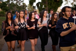 In this May 24, 2014 photo, students march on the campus of the University of California, Santa Barbara during a candlelight vigil held to honor the six victims of a mass killing in Isla Vista, Calif. Sheriff's officials said Elliot Rodger, 22, went on the rampage near UC Santa Barbara. Accounts of Rodger's hostility to women, and his bitterness over sexual rejection, led to an outpouring of commentary and online debate over the extent of misogyny and male entitlement. (AP Photo/Jae C. Hong)
