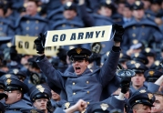 An Army cadet cheers in the stands in the first half of an NCAA college football game against Navy in Landover, Md., Saturday, Dec. 10, 2011. (AP Photo/Evan Vucci)