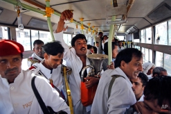 In this Sept. 24, 2014 photo, members of Master Band travel in bus for work, in New Delhi, India. (AP Photo/Manish Swarup)